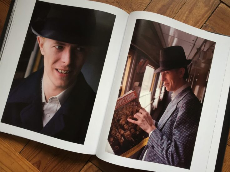 Bowie looks through a French magazine on a train en route to Moscow (click for larger image)
